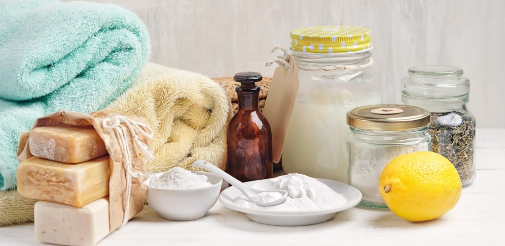 A collection of eco-friendly cleaning products and towels